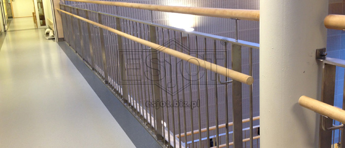 Balustrade made of stainless steel with wooden handrails