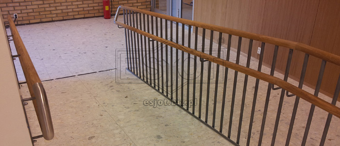 Balustrade made of powder-coated steel with wooden elements and stainless steel elements